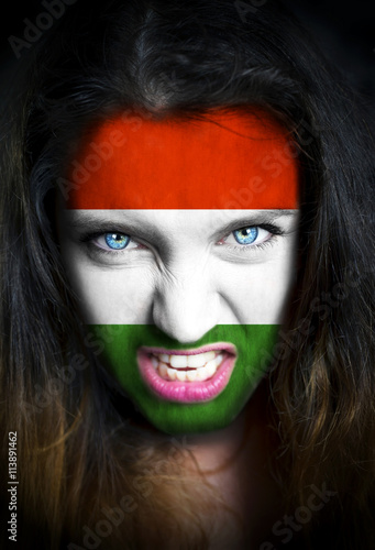 Poster Portrait of a woman with the flag of the Hungary  painted on her face