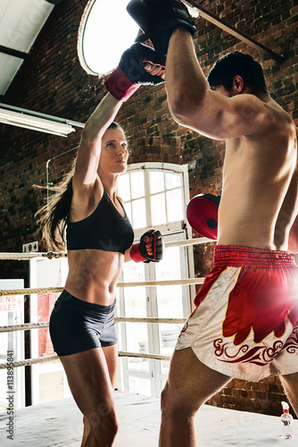 man woman training gym boxing mma ring pads mixed martial arts f Poster