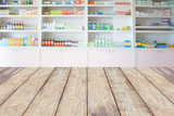 pharmacy wood counter with blur shelves of drug in the pharmacy