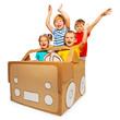 Happy kids waving hands sitting in cardboard car