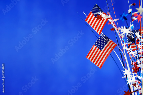 4th of July decorations on blue background Poster