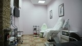 Room for pedicure with two chairs and bathtubs, and wardrobes for towels.Interior of a pedicure salon.Spa center interior.Interior with chairs in new beauty salon.Spa treatments, beauty center