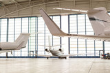 Small Passenger Airplane Leaving Bright Hangar - 113968890