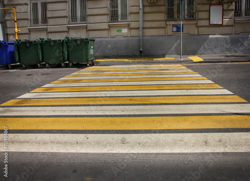 Poster white and yellow lines pedestrian crossing on asphalt and green