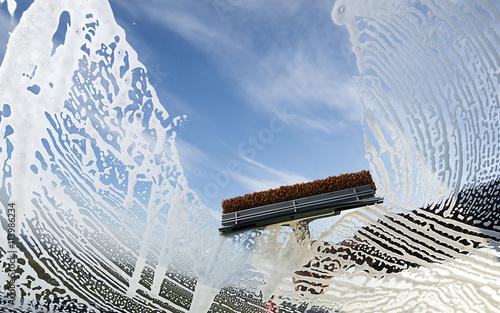 Washing dirty windshield of a car.
