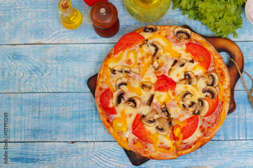 Homemade Hot Supreme PIzza with mushrooms, peppers, ham, tomato and cheese Poster