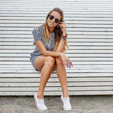 Outdoor portrait of pretty stylish young girl