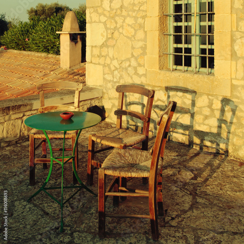 greek country outdoor restaurant on roof terrace, Crete, Greece.