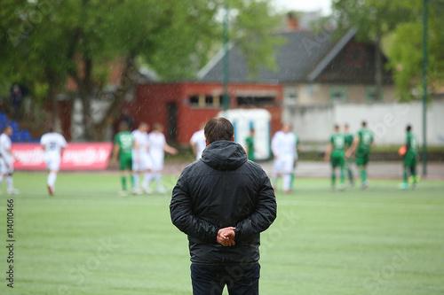 Footbal coach watching the match