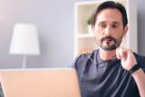 Man looking at his computer