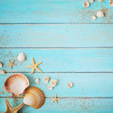 seashells frame background on wooden board