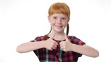 Little  redhead girl with two pigtails is showing thumb up gesture, smiling, isolated on white background