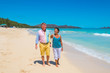 Retirement Couple Strolling Tropical Beach in Hawaii