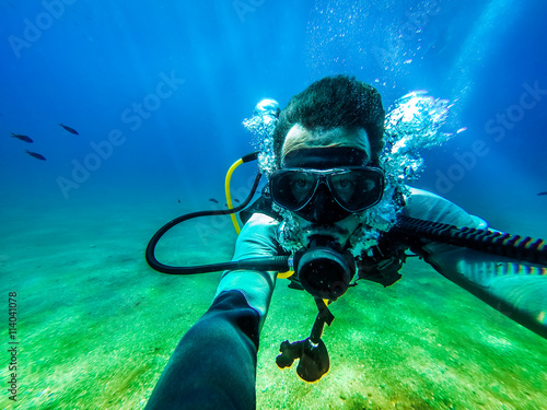 obraz lub plakat Underwater diver selfie.