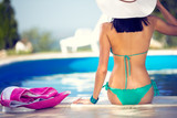 young woman by the pool enjoy in sunbath