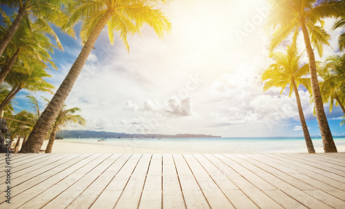 Fototapeta wooden dock with tropical background