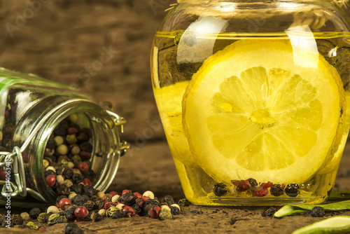 Olive oil flavored with lemon and peppercorns