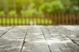Garden wooden table with green bokeh - 114080009