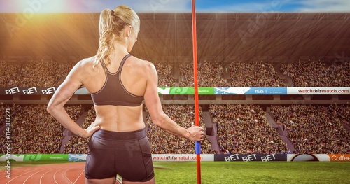 fototapeta na ścianę Composite image of athlete standing with javelin