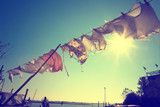Vintage sunny Burano island with hanging laundry to dry in windy and sunny weather. Picture was taken in Burano island, Venice, Italy.