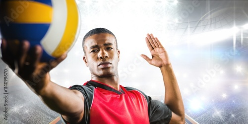 Fototapeta Composite image of sportsman playing a volleyball