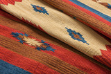 Close up of a hand woven striped patterned indian kilim carpet - 114100045