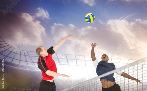 Fototapeta Composite image of sportsmen are playing volleyball