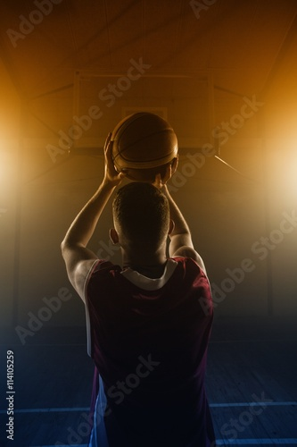 Poster Portrait of basketball player front the back preparing to score