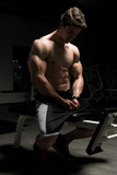 Muscular Man Resting On Bench After Exercise