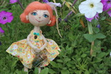 Little delicate handmade fabric textile doll girl butterfly with open eyes ginger hair and purple wings