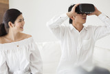 The couple are playing with a VR headset