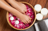 Beautiful female feet at spa salon on pedicure procedure.