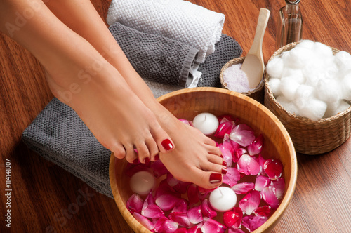Leinwanddruck Bild  Beautiful female feet at spa salon on pedicure procedure.