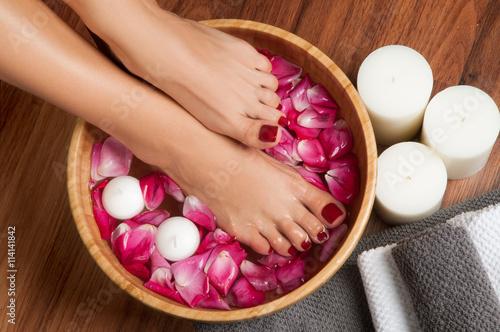 Foto op Aluminium Pedicure Beautiful female feet at spa salon on pedicure procedure.