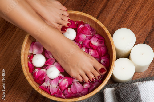 Beautiful female feet at spa salon on pedicure procedure. Poster