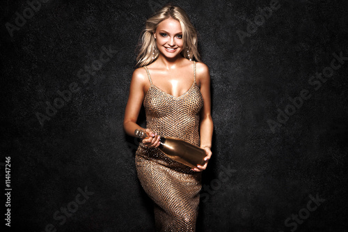 Beautiful sexy blonde woman on black background, party. Poster