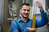Brewer holding hydrometer cylinder