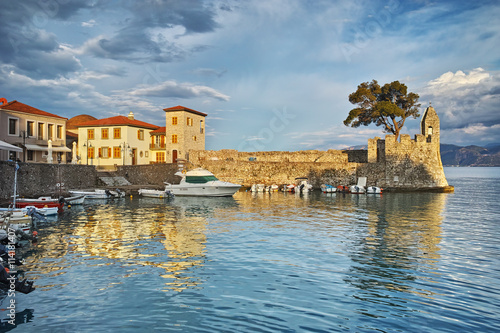 Poster Oceanië Amazing sunset of the port of Nafpaktos town, Western Greece