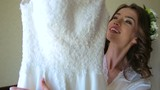 Wonderful bride tries on wedding dress