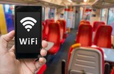 Man holds smartphone with free wifi in train.