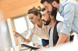 Trendy business team meeting in front of desktop