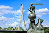 Fototapety The mermaid statue on the Vistula river bank in Warsaw, Poland. Photo with shallow depth of field.