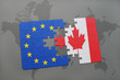 puzzle with the national flag of canada and european union on a world map