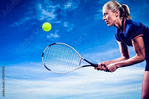Composite image of tennis player playing tennis with a racket  Platno