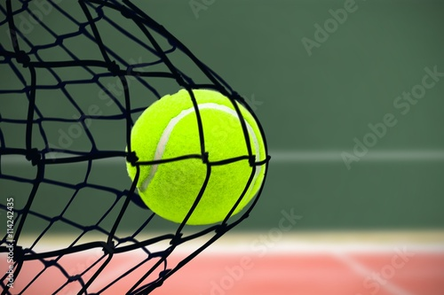 Plakát Composite image of tennis ball with a syringe