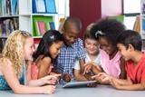 Fototapety Children using digital table in library