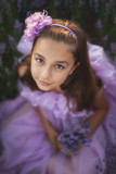 Little girl in a field of lavender - selective focus, copy space