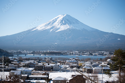 Mount Fuji with village in winter season Plakat