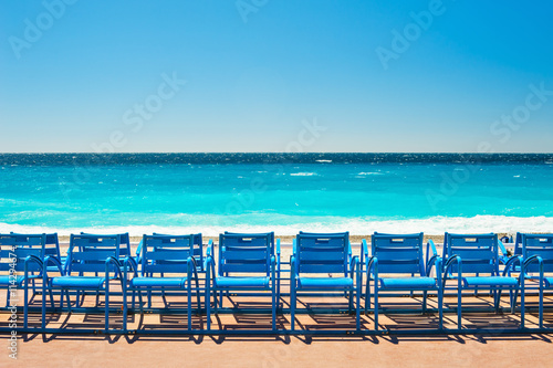 Fotobehang Nice Blue chairs on the Promenade des Anglais in Nice, France