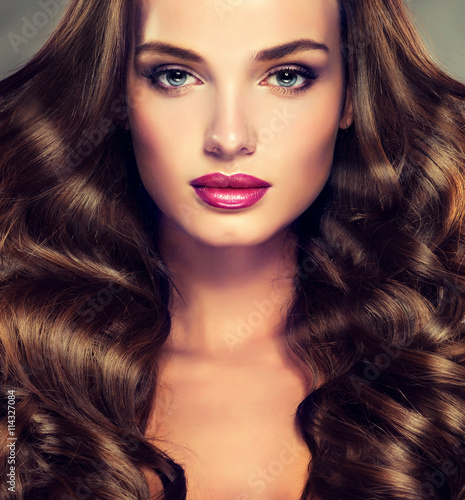 Beautiful girl brunette  hair with an elegant hairstyle , hair wave ,curly hairstyle  Plakat